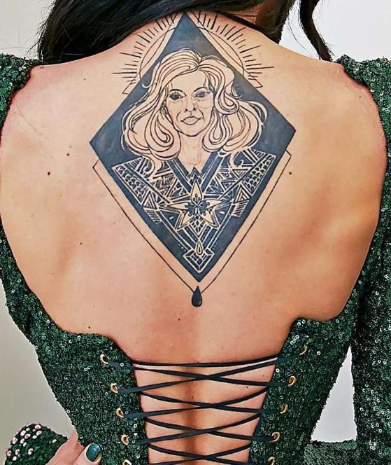 conchita wurst tattoo back mother helga