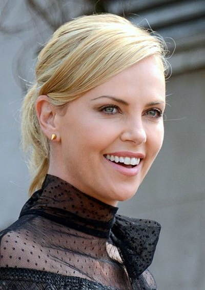 Charlize Theron tells Howard Stern coming to terms with her father's shooting by her mother took years