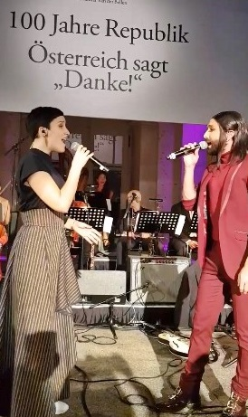Watch Conchita and Ina Regen perform 'Heast as net' live at the 100 Years of the Republic of Austria celebration
