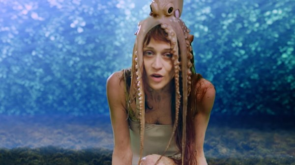 Screenshot of Fiona Apple from 'Every Single Night' video with an octopus on her head